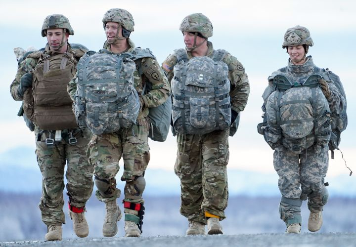 Soldiers from 4/25 IBCT (A) making their way to a rally point after conducting a parachute jump.