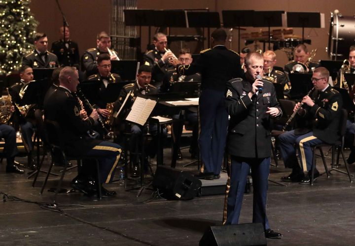 Sgt. Bachrach sings holiday music at the 9th Army Band Holiday Spectacular.