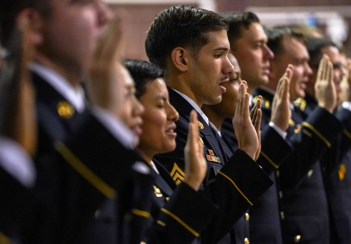Soldiers recite the noncommissioned officer creed during an NCO induction ceremony.