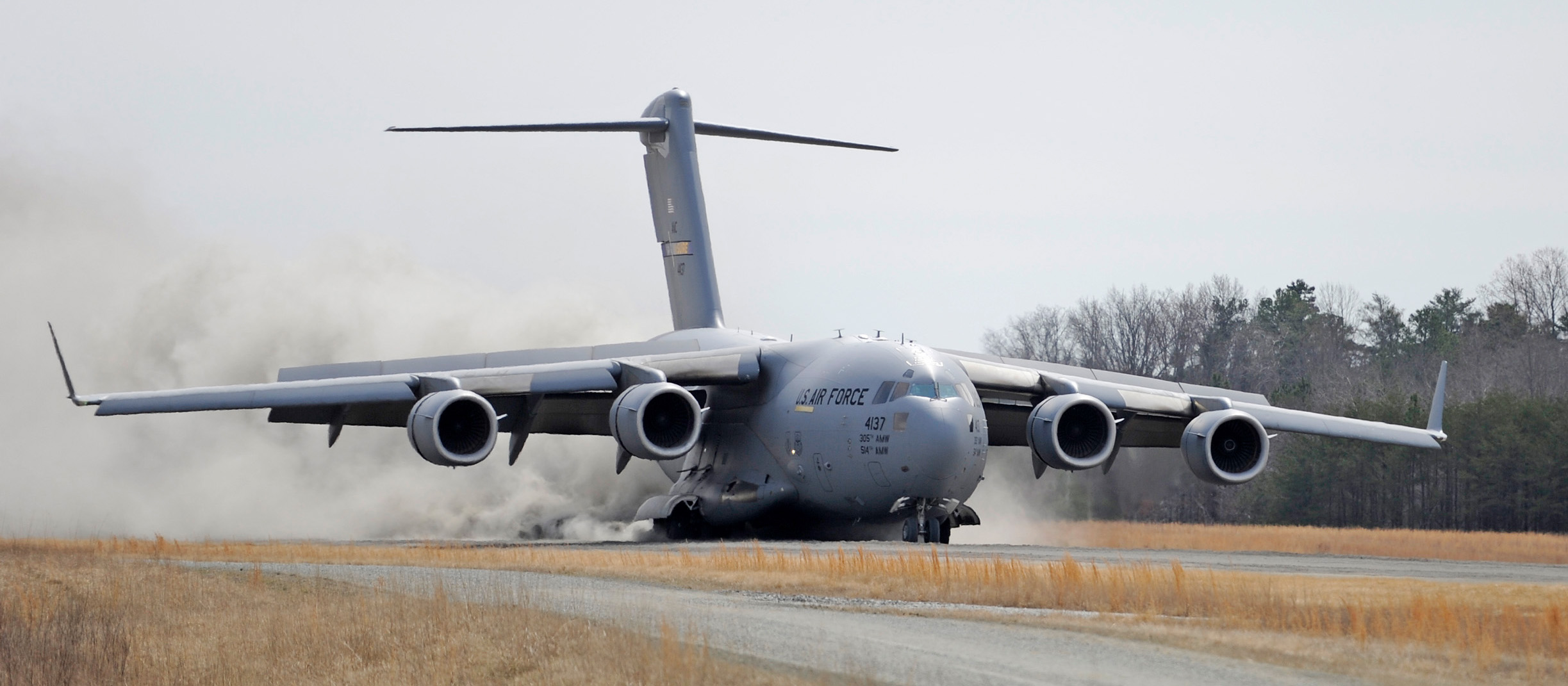 U.S. Air Force C-17 Globemaster III aircraft practice landings at austere airfields
