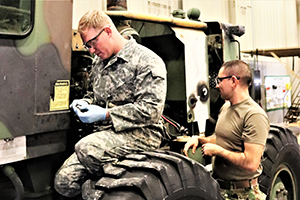Photo: Students in the 91L10 Construction Equipment Maintenance Repairer Course work together to take an engine out of a grader Feb. 20 during training at the Regional Training Site-Maintenance facility at Fort McCoy.