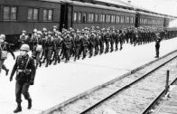 Photo of troops arriving by rail to train at Camp McCoy