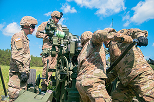 Photo: Soldiers assigned to the 426th Regiment (Field Artillery) Regional Training Institute load an M777 A2 Howitzer cannon with an M1122 155-mm projectile during their culminating live-fire exercise July 27 at Fort McCoy.
