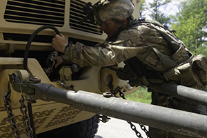 Photo: Spc. Brandon Harding with the 702nd Engineer Company, based in Grey, Tenn., conducts vehicle recovery operations July 22 during Combat Support Training Exercise 86-19-03 at Fort McCoy.