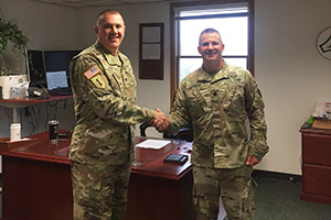 Photo: Garrison Commander Col. Michael Poss (left) welcomes incoming Garrison Deputy Commander Lt. Col. Chad Maynard to his new office July 9 at Fort McCoy.