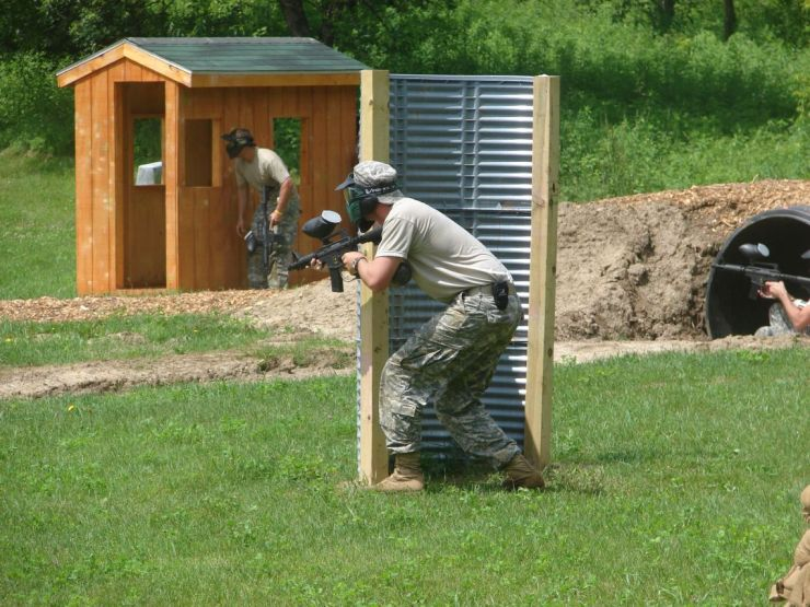This is a photo of individuals playing paint ball at Fort McCoy