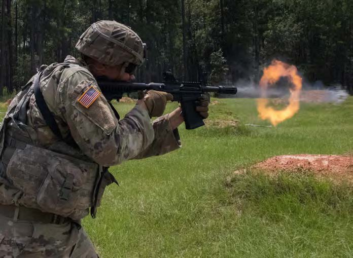 Spc. Don Keller, with Co. A, 10th BEB, 1ABCT, 3rd ID, fires his M26 shotgun at a firing range on Fort Stewart, Aug 23. On Aug. 27, Soldiers from Co. A, 10th BEB, returned to range to engage pop-up targets during a live fire qualification at a firing range on Fort Stewart. The Soldiers fired at targets ranging from 50-meters away, to 300-meters. They had to do this in three different firing positions; the prone supported, prone unsupported and kneeling position.